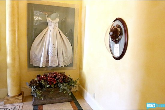Preservation at its finest: Real Housewife Adrienne Maloof, actually had her wedding dress framed and hung on her wall!