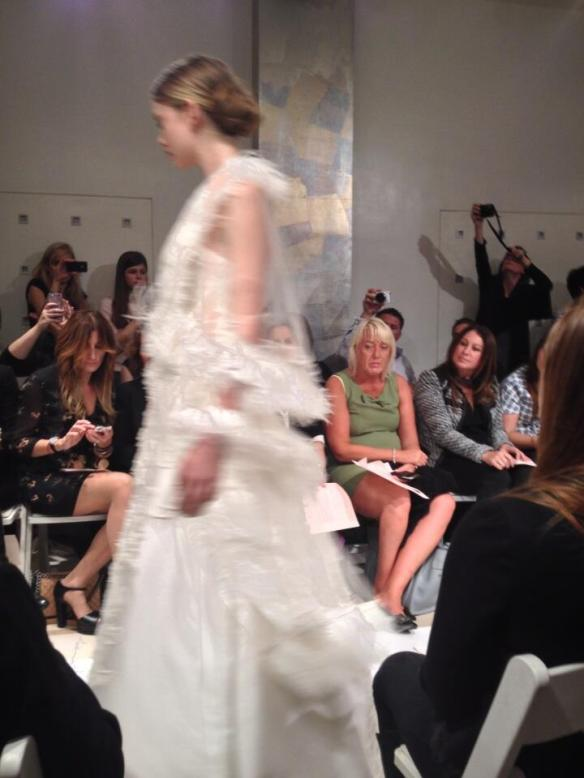Blurry bride walking by me on the runway at the Reem Acra show.