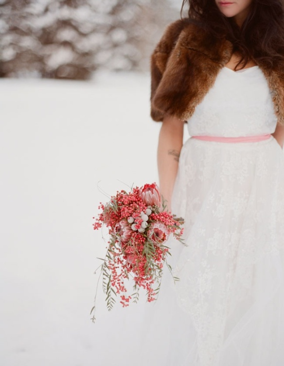 To see this beautiful bride's winter wedding, visit greenweddingshoes.com