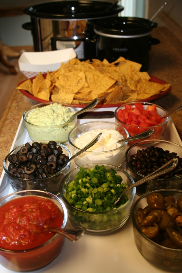 Image via http://themagicalslowcooker.com/2013/01/21/super-bowl-nacho-bar/